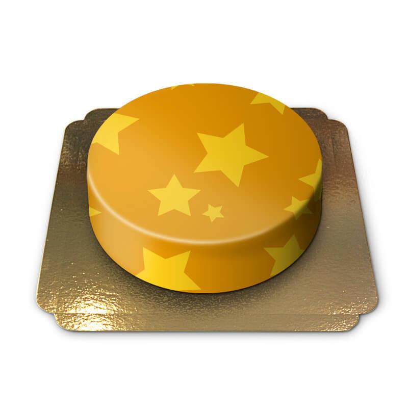 Żółty tort ze wzorem w gwiazdki