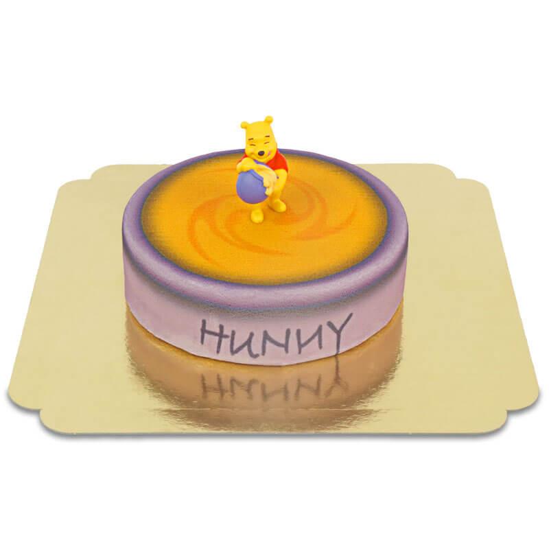 Winnie de Poeh op honing pot taart